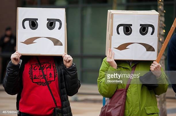 Demonstrators wear costumes during a protest at Amazoncom Inc headquarters in Seattle Washington US on Monday Dec 16 2013 Amazoncom Inc workers in...