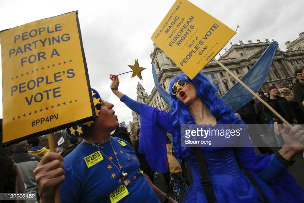 Demonstrators wear costumes in the likeness of the European Union flag and hold placards during the antiBrexit People's Vote rally in London UK on...
