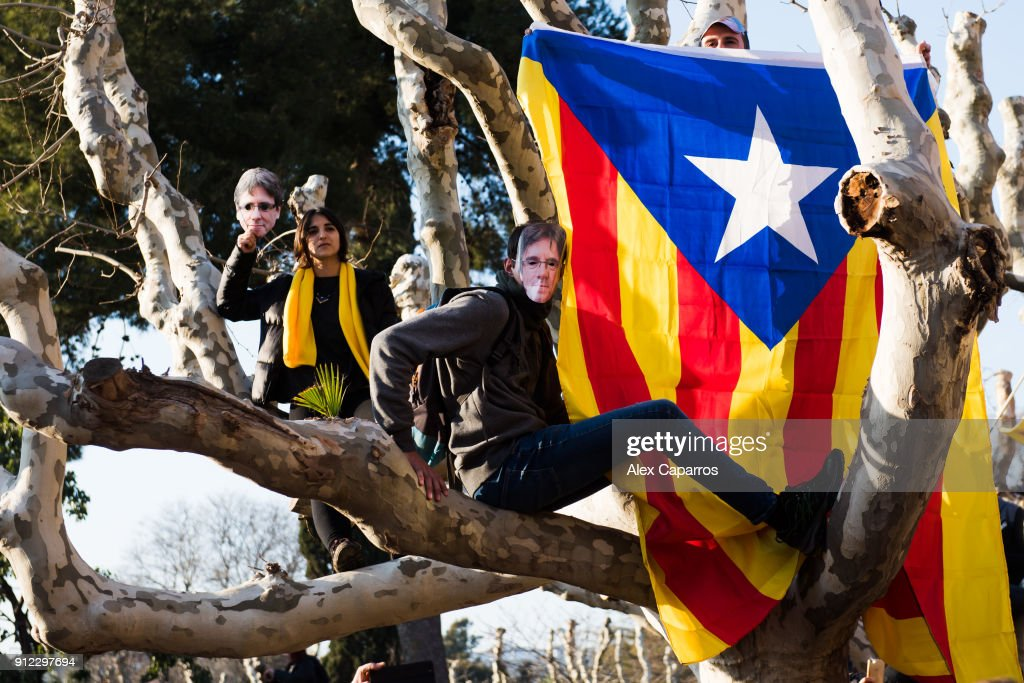 Demonstrators wear cut-out masks of the former Catalan President Carles Puigdemont as they take part in a protest in front of the Parliament of Catalonia on January 30, 2018 in Barcelona, Spain. The President of the Parliament of Catalonia, Roger Torrent has called off the parliamentary session scheduled for today to form a new regional government. The Spanish Constitutional Court ruled on Saturday that Carles Puigdemont, who was proposed by the pro-independence parties as the candidate to be the new President of Catalonia, has to be present to be elected as the new region's President. Carles Puigdemont, who fled Spain for Belgium to avoid arrest for leading a secession bid, is facing possible charges of rebellion, sedition and misuse of public funds and faces arrest if he returns from Brussels.
