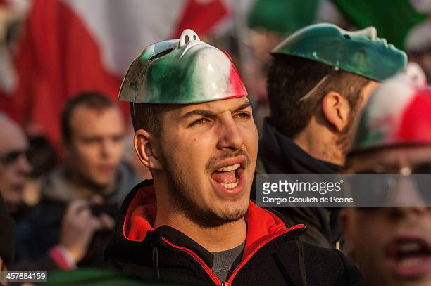 Demonstrators wear masks as they take part in the protest of the Forconi Movement at Piazza del Popolo on December 18, 2013 in Rome, Italy. The I...
