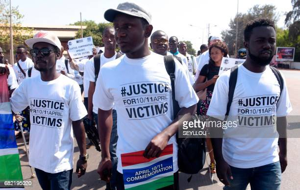 Demonstrators wear shirts reading 'Justice for 10/11 April Victims' during a march in rememberance of victims of The Gambia's former regime in...