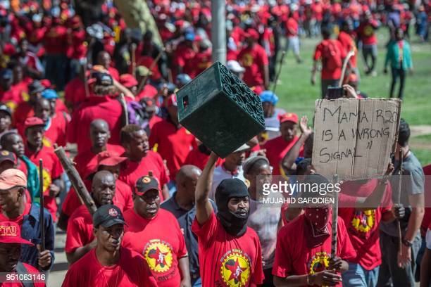 TOPSHOT Demonstrators wearing a tshirt of the National Union of Metalworkers of South Africa take part in a national strike called by South African...