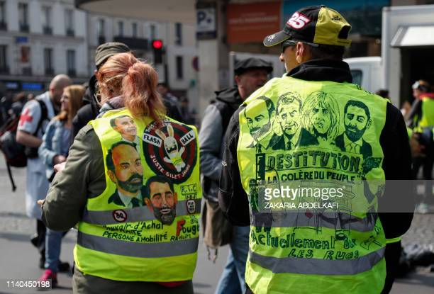 Demonstrators wearing a yellow vest on which is written 'dismissal people's anger' stand in the district of Montparnasse prior to the start of May...