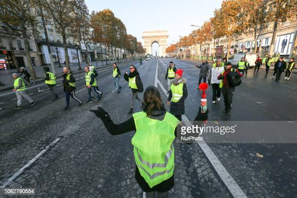 Demonstrators wearing a Yellow Vest protest against the rising of the fuel and oil prices on November 17 2018 in Paris in front of the Arc de...