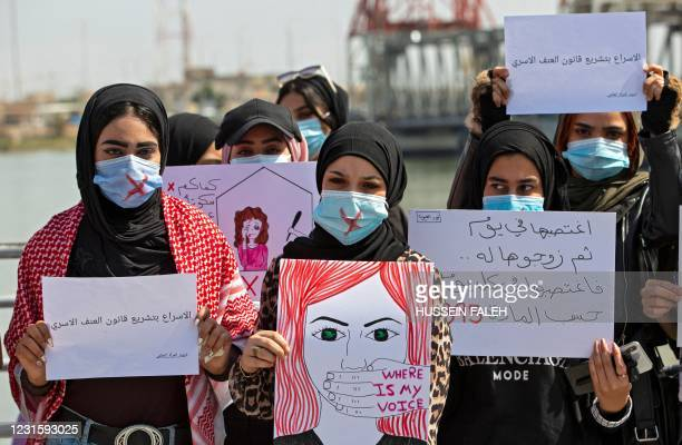 Demonstrators wearing cross-out masks attend a rally for International Women's Day in Iraq's southern city of Basra on March 8, 2021.