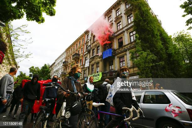 Demonstrators wearing face masks gather at a May Day protest during the novel coronavirus pandemic on May 1, 2020 at Oranien Square in Kreuzberg,...