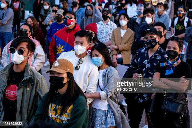 "Demonstrators wearing face masks take part in a rally ""Love Our Communities: Build Collective Power"" to raise awareness of anti-Asian violence, at..."