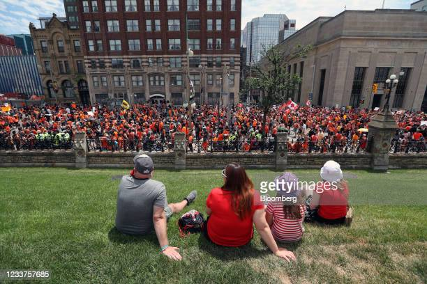 Demonstrators wearing orange in solidarity with survivors of residential schools march to Parliament Hill on Canada Day in Ottawa, Ontario, Canada,...