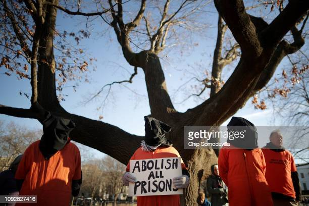 Demonstrators wearing orange jumpsuits and hoods over their heads rally to demand closure of the detention camp at the US Naval Station in Guantanamo...