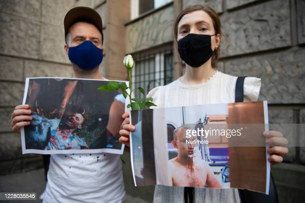 Demonstrators wearing protective face masks hold pictures of the victims of Belarusian police brutality in front of the European Commission building...