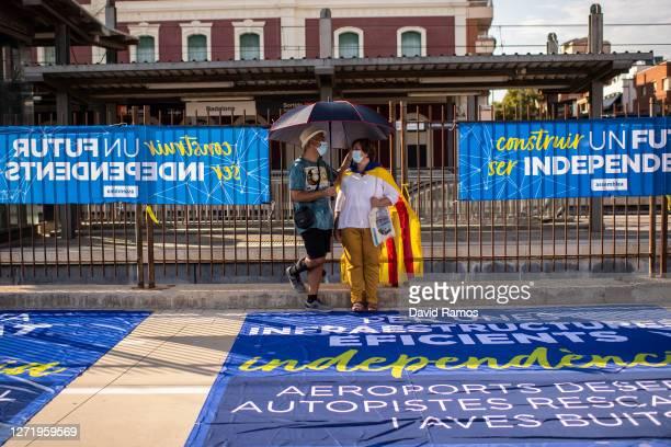 Demonstrators wearing protective face masks observe social distancing guidelines during a Catalan Pro-Independence demonstration on September 11,...
