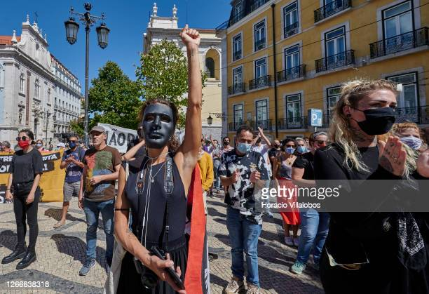 """Demonstrators wearing protective masks gather under the motto """"Unidos Contra O Fascismo"""" in Luís de Camões Square during the COVID-19 Coronavirus..."""