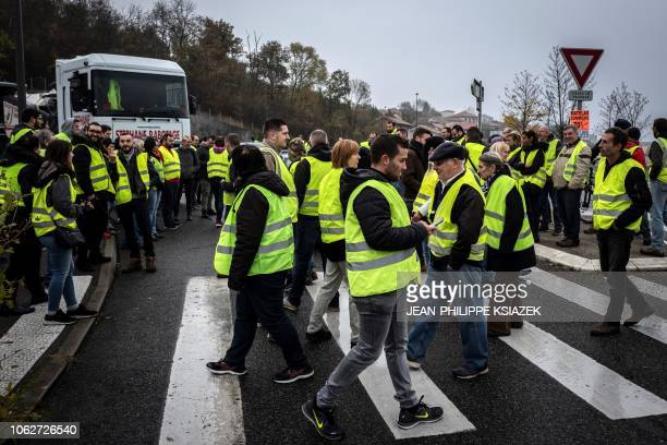 Demonstrators wearing yellow vests protest against the rising of the fuel and oil prices on November 17 2018 in front Carrefour Market in Givors East...