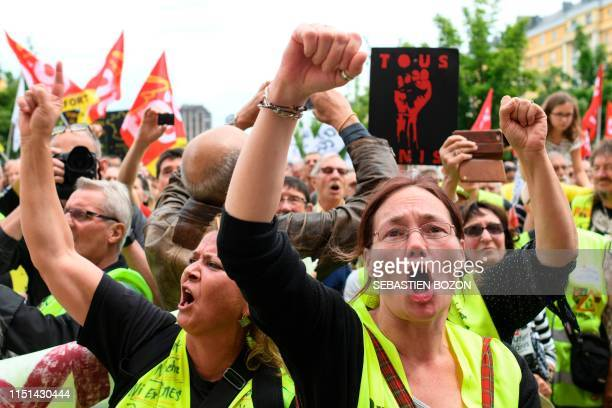Demonstrators wearing Yellow Vests shout and gesture during a demonstration held to support the employees of US giant General Electric Belfort,...