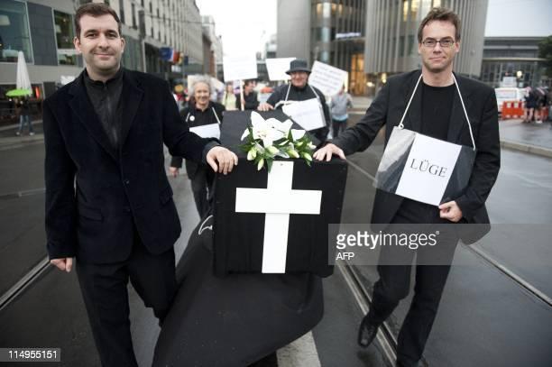 Demonstrators wheel a coffin symbolising trust during a protest against Berlin's new Schoenefeld airport the Berlin Brandenburg International airport...