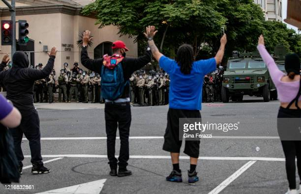 Demonstrators who refused to disperse during curfew clash with Riverside County Sheriff deputies during a demonstration against the death of George...