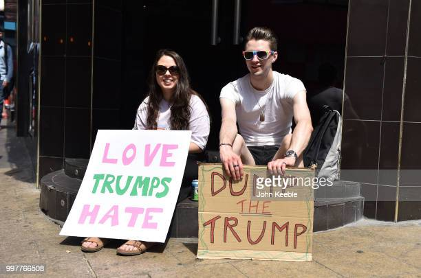 Demonstrators with an anti Trump placards saying 'Love Trumps Hate' and Dump The Trump' attend the Drag Protest Parade LGBTQi March against Trump on...