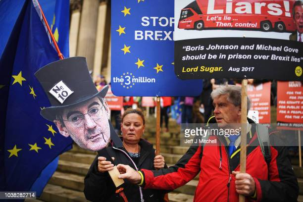 Demonstrators with an effigy of Conservative MP Jacob ReesMogg on the March For The Many on September 23 2018 in Liverpool England The March For The...