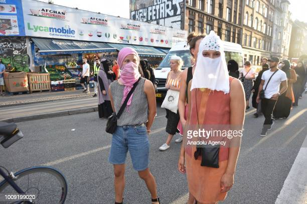 Demonstrators with face veils gather to protest ban on the wearing of face veils at the Black Square in Copenhagen Denmark on August 01 2018 Denmark...