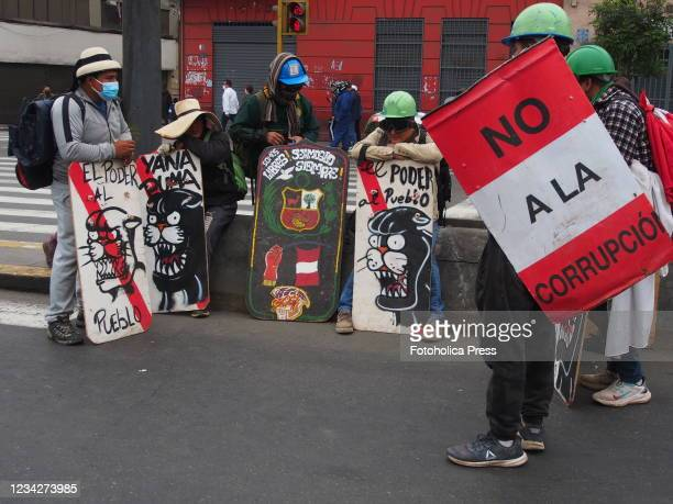 Demonstrators with homemade shields when on the day of Pedro Castillo's presidential inauguration his supporters take to the streets to demand a new...