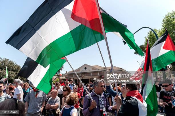 Demonstrators with Palestinian flags during a rally to celebrate the 73rd Liberation Day on April 25 2018 in Rome Italy Italy's Liberation Day is a...