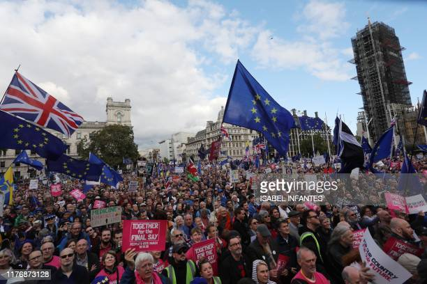 Demonstrators with placards and EU and Union flags gather in Parliament Square in central London on October 19 as they take part in a rally by the...