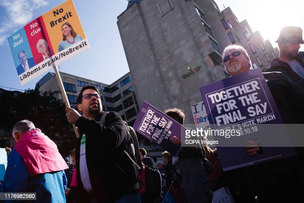 Demonstrators with placards at Park Lane during the protest A mass 'Together for the Final Say' march organised by the 'People's Vote' campaign for a...