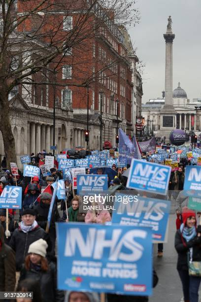 Demonstrators with placards march during a protest calling for an end to the 'crisis' in the staterun National Health Service in central London on...