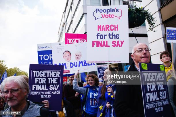 Demonstrators with placards on Piccadilly during the protest A mass 'Together for the Final Say' march organised by the 'People's Vote' campaign for...