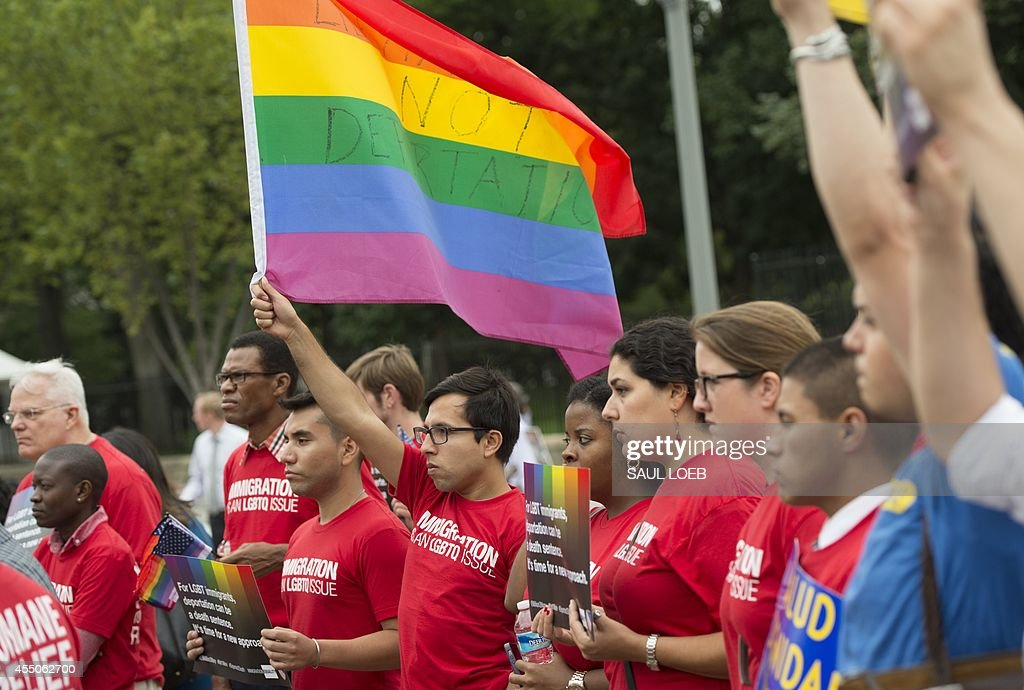 Demonstrators with the group GetEQUAL hold a protest with lesbian, gay, bisexual and transgender (LGBT) individuals affected by the country's immigration policies during a rally outside the White House in Washington, DC, September 9, 2014. AFP PHOTO / Saul LOEB
