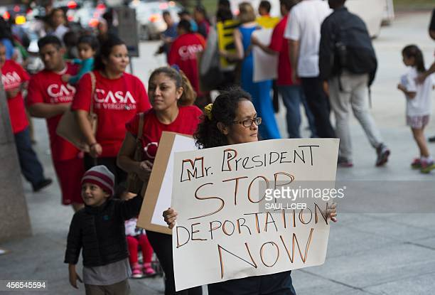Demonstrators with the groups National Day Laborer Organizing Network Workers United of Washington and the #Not1More Campaign protest an increase in...
