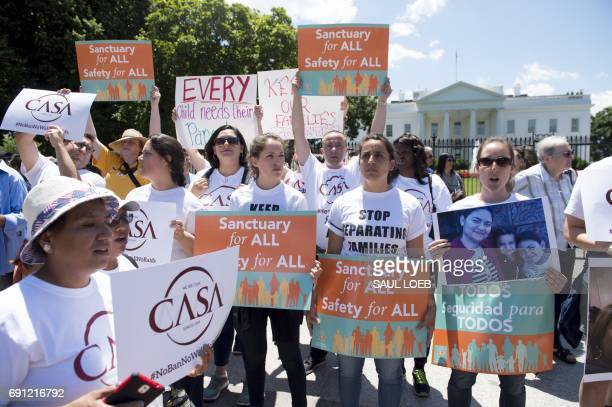 Demonstrators with the organization CASA protest US President Donald Trump's immigration and deportation policies during a rally outside the White...