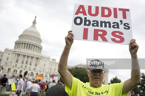 Demonstrators with the Tea Party protest the Internal Revenue Service targeting of the Tea Party and similar groups during a rally called Audit the...