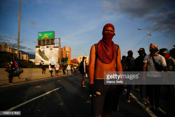 Demonstrators with their faces covered protest against the government of Nicolás Maduro on February 2 2019 in Caracas Venezuela Venezuela's...