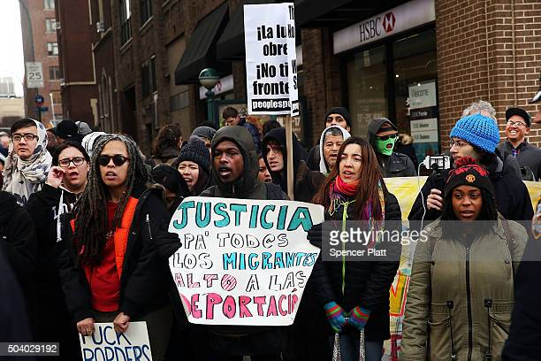 Demonstrators yell at police during a protest outside the Immigration Court in New York City on January 8 2016 in New York City The afternoon protest...