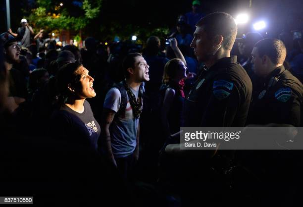 Demonstrators yell at police during a rally for the removal of a Confederate statue coined Silent Sam on the campus of the University of Chapel Hill...