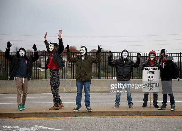 Demonstrators yell Hands Up Don't Shoot alongside a highway overpass to voice their opinions as the area awaits a grand jury decision on November 15...