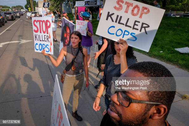 Demonstrators/protestors gather for a vigil near the spot where Philando Castile was fatally shot by a St Anthony police officer Monday August 29 in...