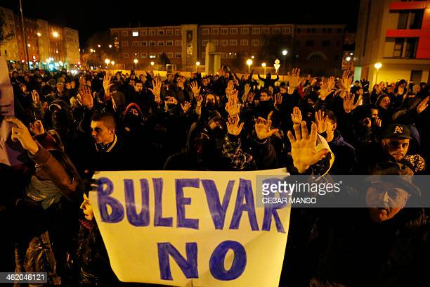 Demonstratprs hold a sign saying 'No Boulevard' during a protest against imminent construction works to revamp Vitoria street the city's main...