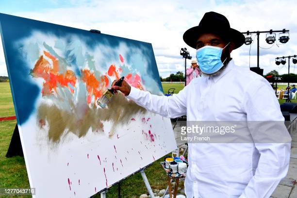 Demont Pinder, artist and historian, paints a live painting at Grandiosity Events 4th annual Polo & Jazz celebrity charity benefit hosted by Real...