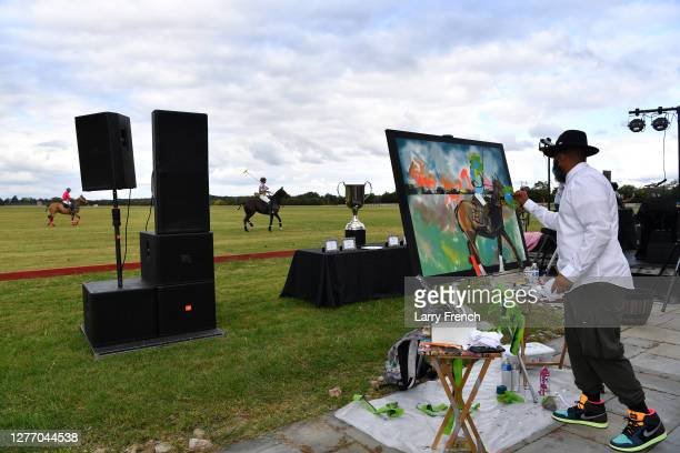Demont Pinder, artist and historian paints a live painting at Grandiosity Events 4th annual Polo & Jazz celebrity charity benefit hosted by Real...