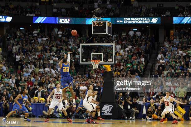 Demonte Harper of the Morehead State Eagles shoots the game winning three point shot with 5.5 seconds left on the clock against the Louisville...