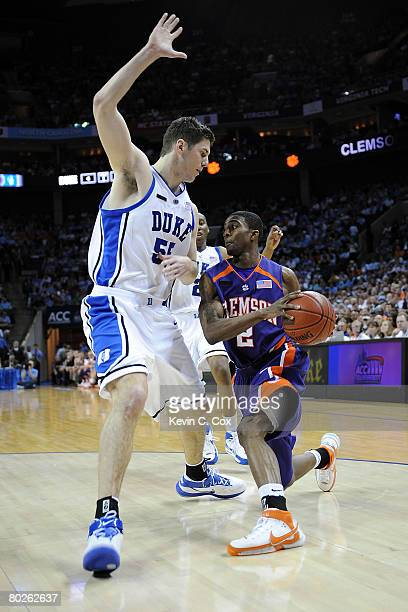 Demontez Stitt of the Clemson Tigers drives on Brian Zoubek of the Duke Blue Devils during the semifinals of the 2008 Men's ACC Basketball Tournament...
