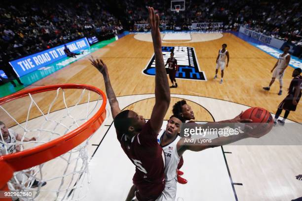 Demontrae Jefferson and Trayvon Reed of the Texas Southern Tigers block a shot by Paul Scruggs of the Xavier Musketeers during the game in the first...