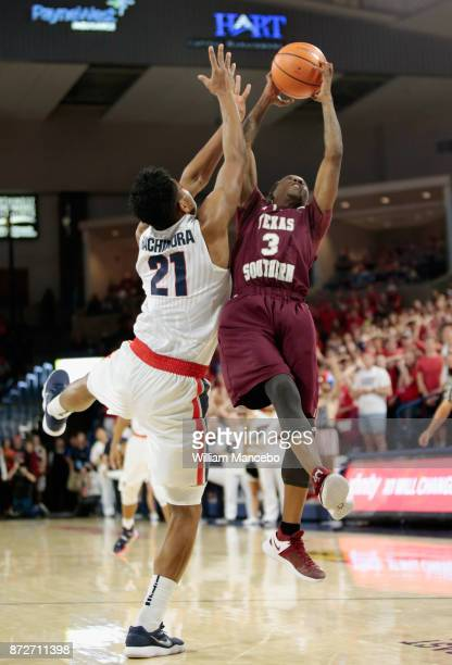 Demontrae Jefferson of the Texas Southern Tigers reaches for a rebound against Rui Hachimura of the Gonzaga Bulldogs in the second half at McCarthey...