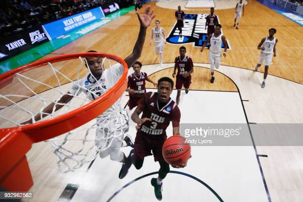 Demontrae Jefferson of the Texas Southern Tigers shoots a layup over Naji Marshall of the Xavier Musketeers during the game in the first round of the...