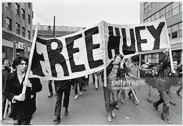 Demontrators march with a 'Free Huey' banner in support of the Black Panther Party New York New York April 4 1970 The banner refers to imprisoned...
