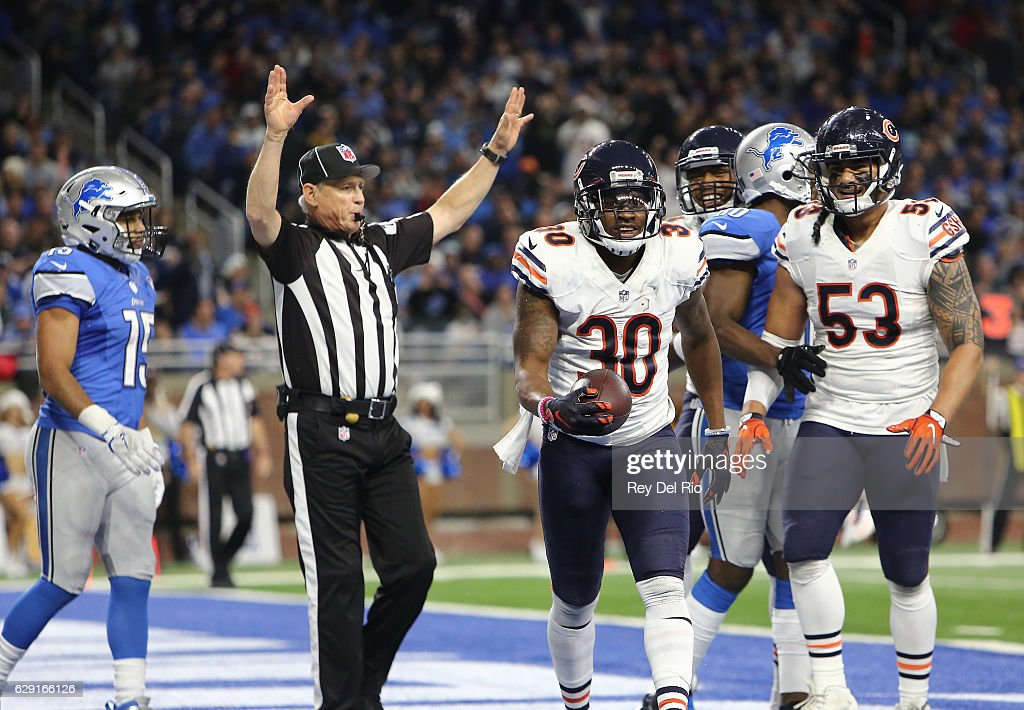 Demontre Hurst #30 of the Chicago Bears celebrates after an interception intended for Golden Tate #15 of the Detroit Lions in the fourth quarter at Ford Field on December 11, 2016 in Detroit, Michigan.