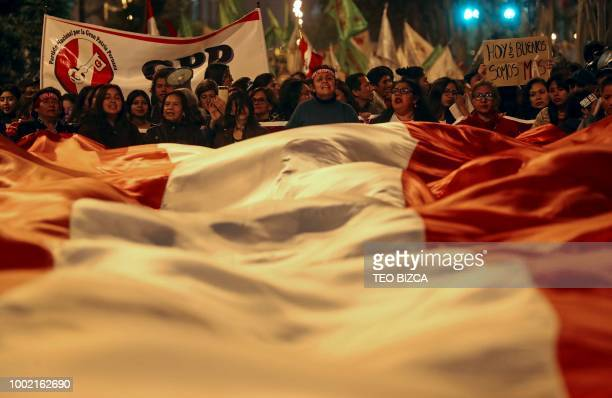 Demontrstors take part in a march against corruption in Lima on July 19 2018 Outraged Peruvians marched on Thursday all over the country to protest...