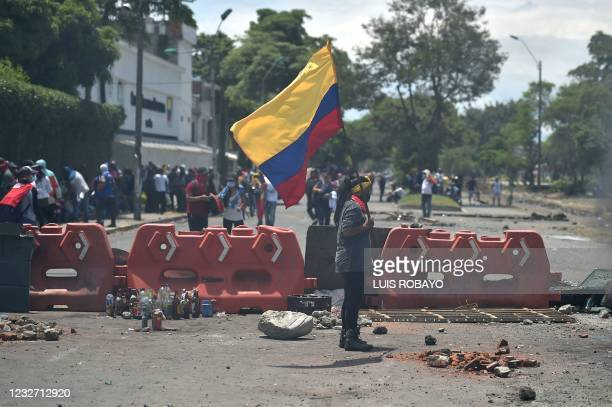 Demostrators block a street with a barricade during a protest against President Ivan Duque's government in Cali, Colombia on May 5, 2021. - Thousands...